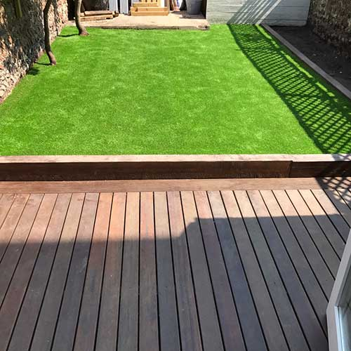 Small area of artificial grass with decking area